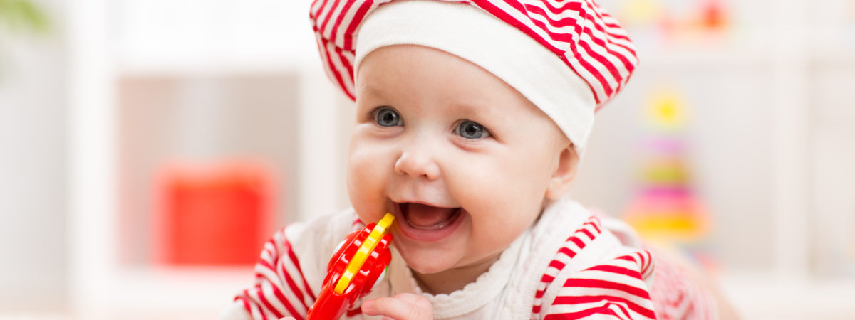 Cute baby child girl in hat having fun
